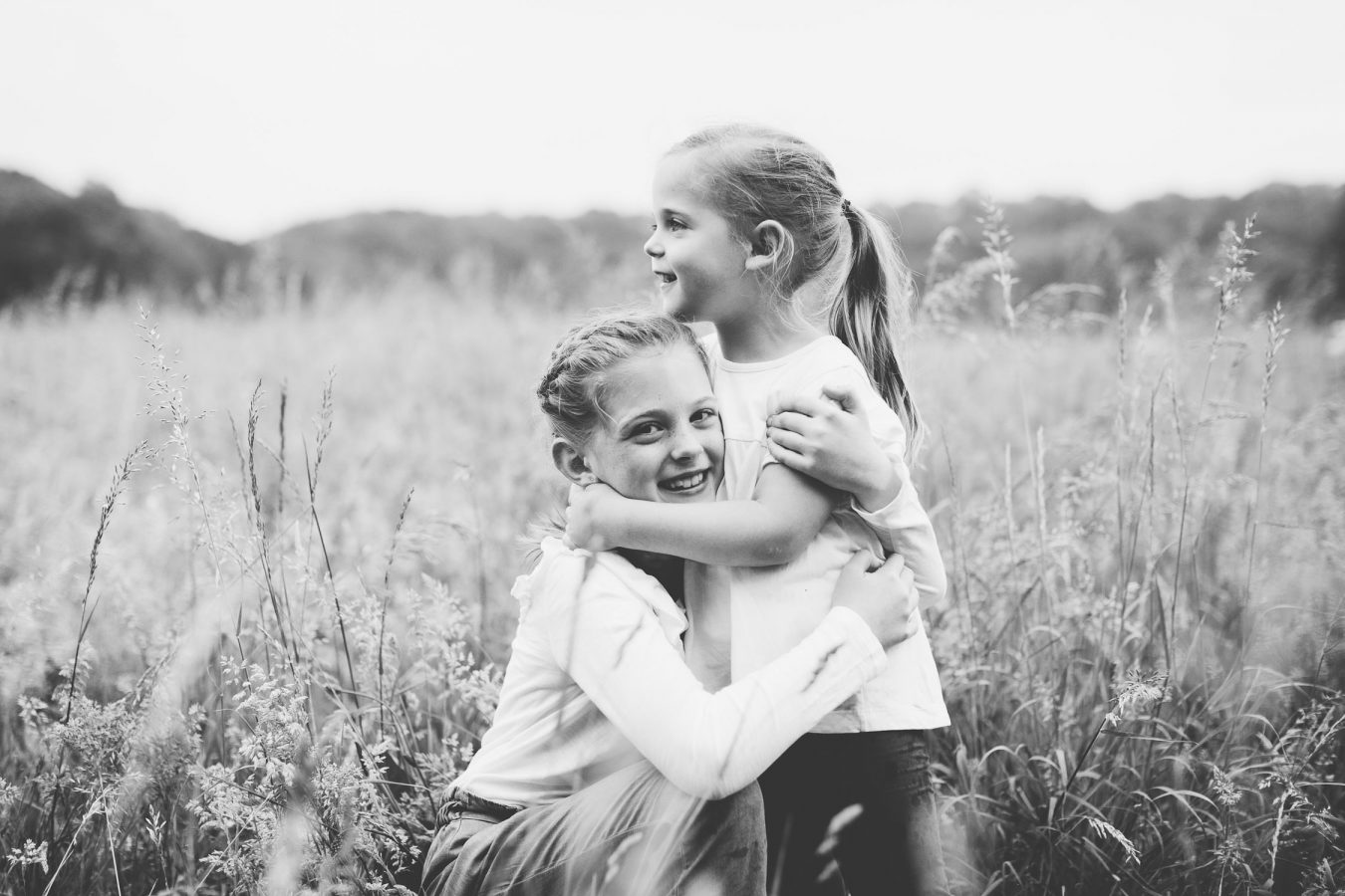 little sisters hugging in st Catherines park Lucan