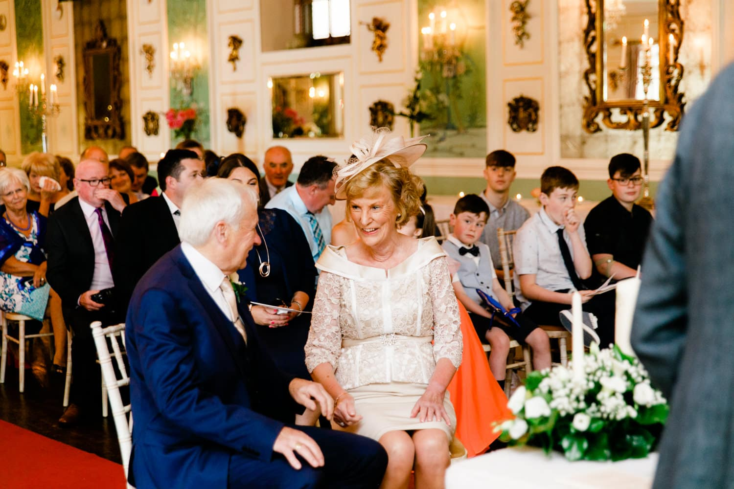 bride laughs at groom top of aisle wedding at Castle Durrow