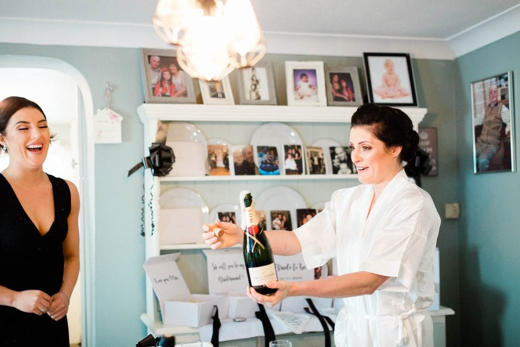 bride opens champagne wedding morning fallons restaurant kilcullen Kildare