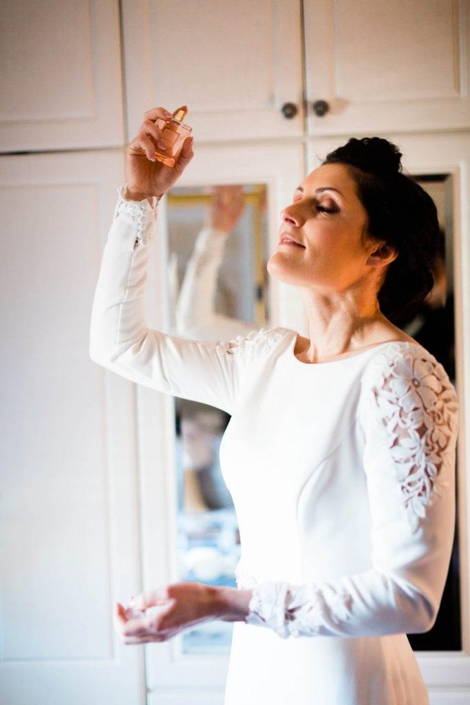 bride puts on perfume wedding morning fallons restaurant kilcullen Kildare