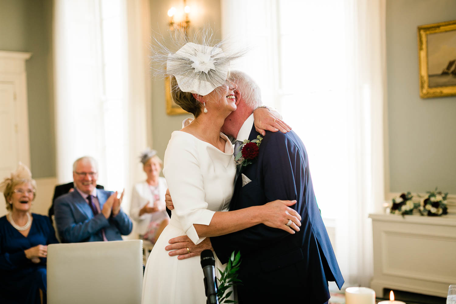 bride and groom hug The Merrion Hotel Dublin wedding