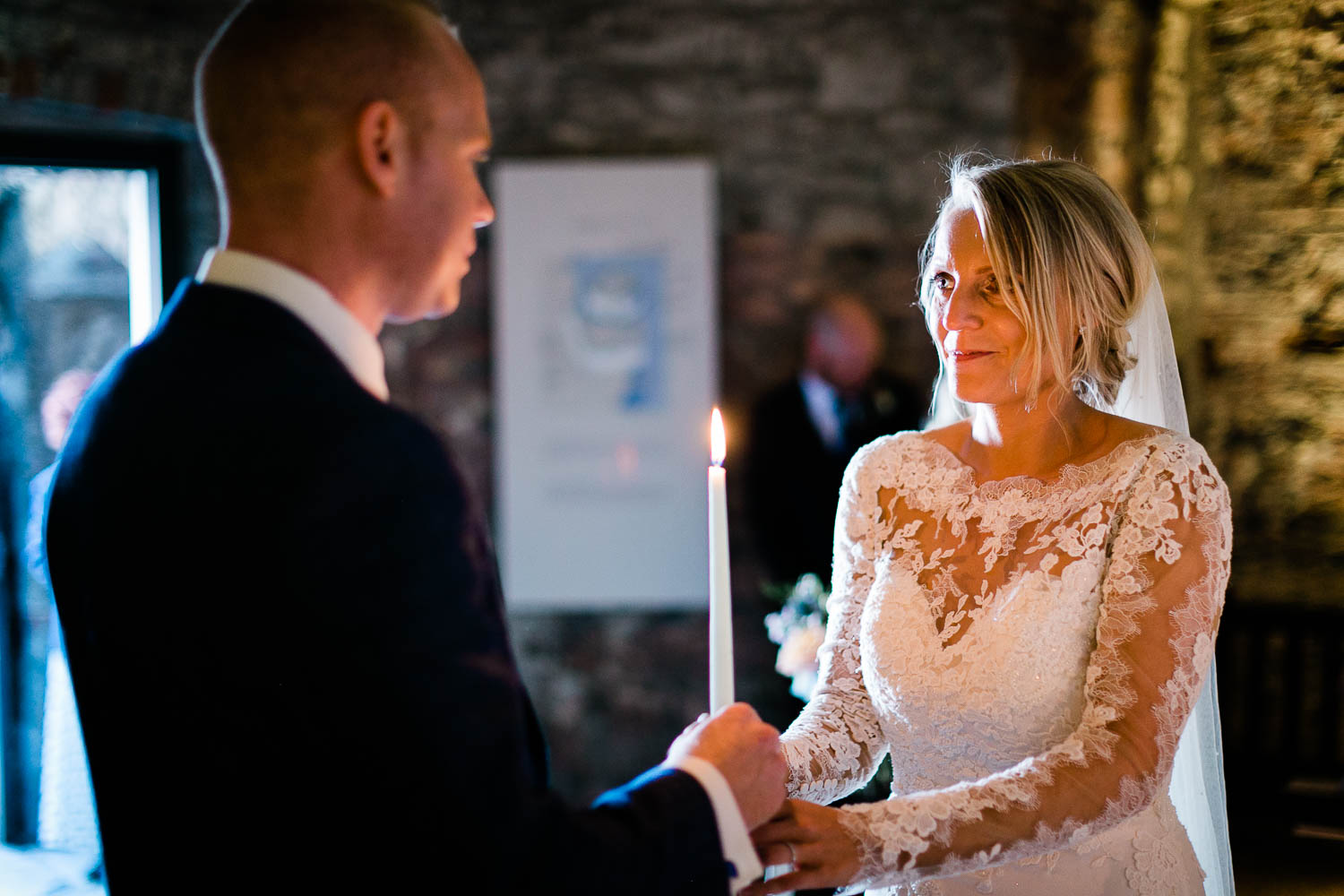 bride and groom hold candle wedding Dungarvan Castle Waterford