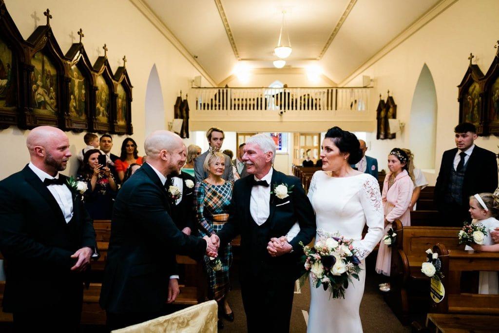 bride meets groom at top of aisle fallons restaurant kilcullen Kildare