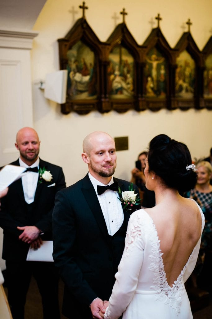 groom looks at bride in church fallons restaurant kilcullen Kildare