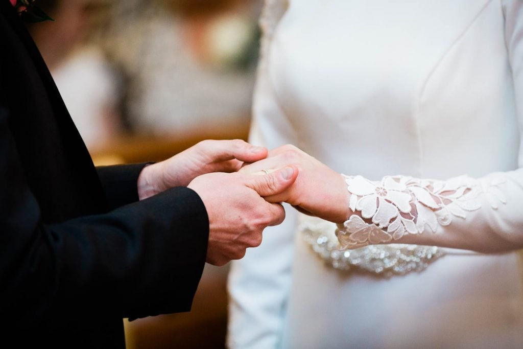 groom holds bride hands in church fallons restaurant kilcullen Kildare