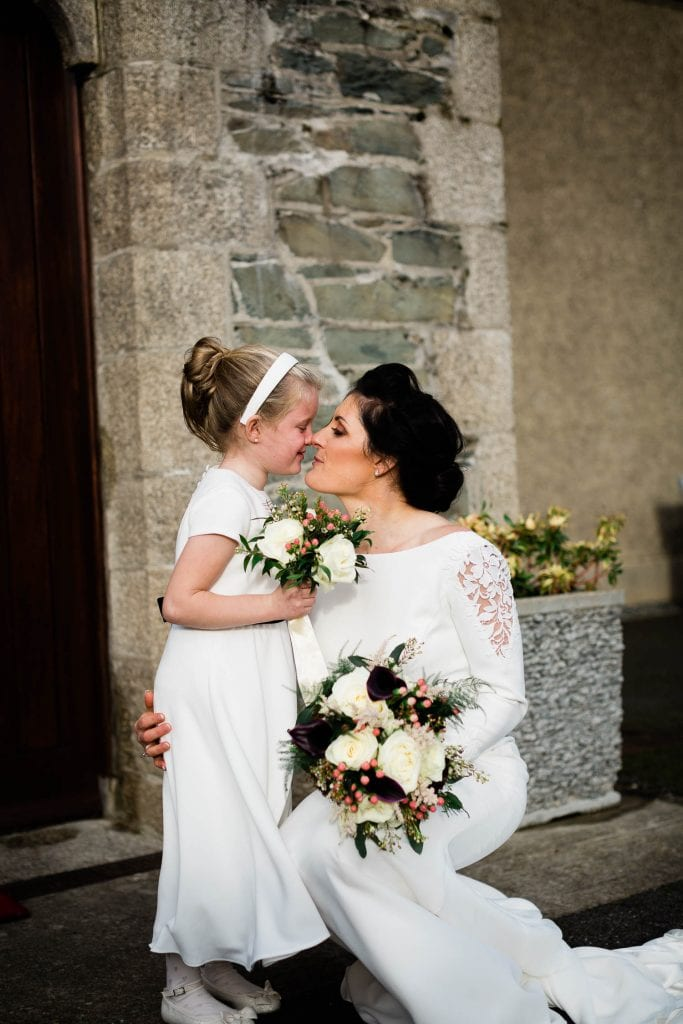 bride kissing daughter outside church on wedding day fallons restaurant kilcullen Kildare