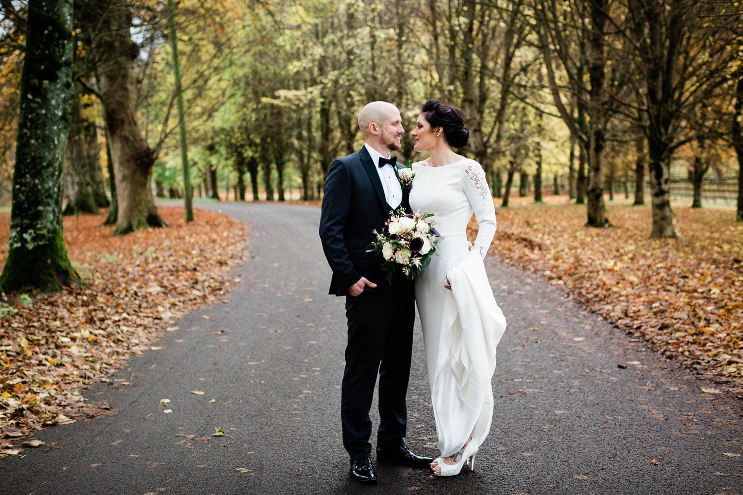 bride and groom looking at each other couple portraits the curragh fallons restaurant kilcullen Kildare