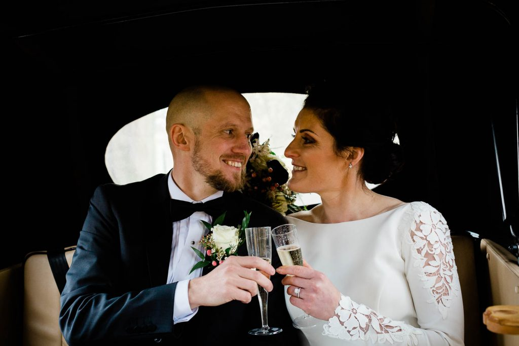 bride and groom cheers in wedding car fallons restaurant kilcullen Kildare