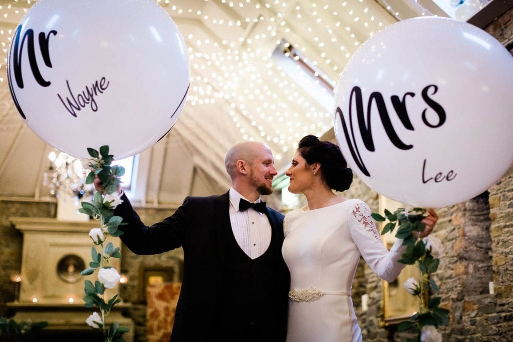 bride and groom holding mr and mrs wedding balloons fallons restaurant kilcullen Kildare