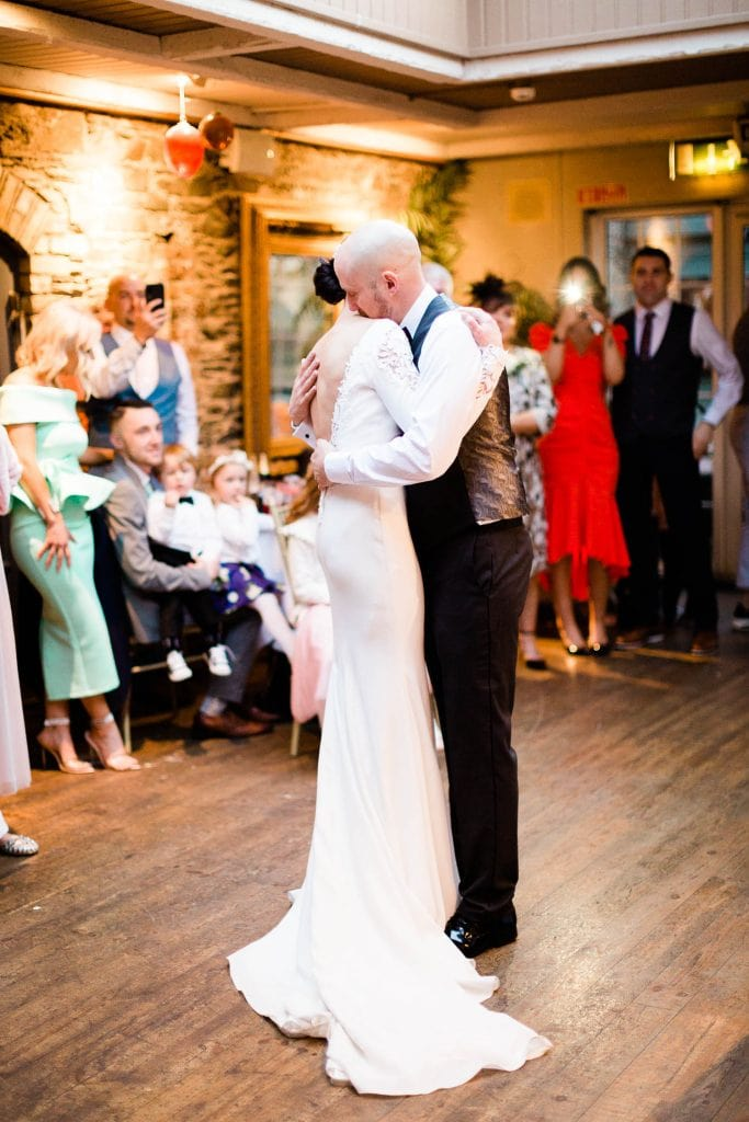 bride and groom hugging first dance fallons restaurant kilcullen Kildare